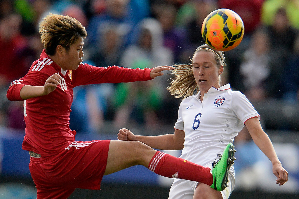 . Li Ying (10) of China defends Whitney Engen (6) of the U.S.A. during the second half of the U.S.A.\'s 2-0 win. Dick\'s Sporting Goods Park on Sunday, April 6, 2014. (Photo by AAron Ontiveroz/The Denver Post)