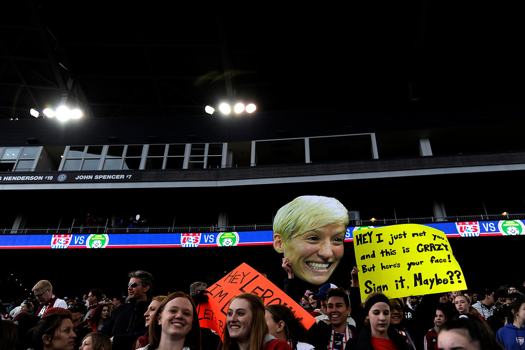 . Fans hold a cutout of Megan Rapinoe (15) of the U.S.A. as the team plays China during team U.S.A.\'s 2-0 win. Dick\'s Sporting Goods Park on Sunday, April 6, 2014. (Photo by AAron Ontiveroz/The Denver Post)