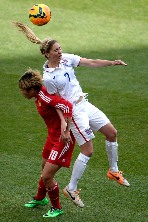 . COMMERCE CITY, CO - APRIL 06: Morgan Brian (7) of the U.S.A. heads the ball away from Li Ying (10) of China during the second half of the U.S.A.\'s 2-0 win. Dick\'s Sporting Goods Park on Sunday, April 6, 2014. (Photo by AAron Ontiveroz/The Denver Post)