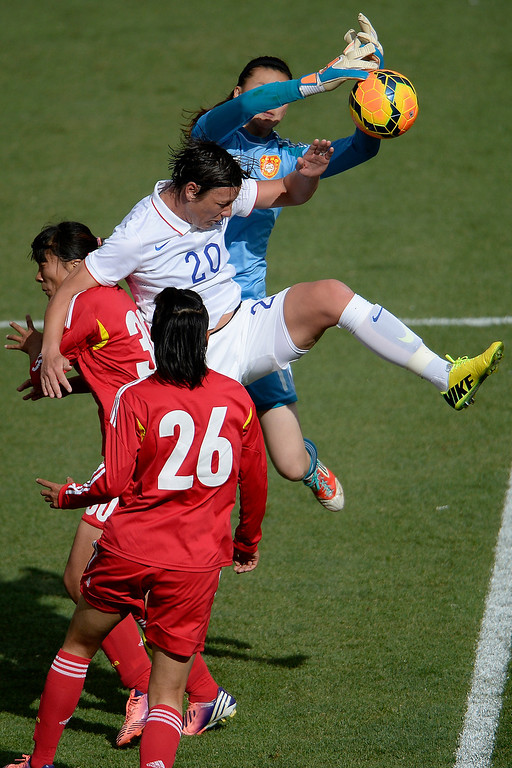 . Abby Wambach (20) of the U.S.A. and Zhang Yue (1) of China contend for a ball in the box during the second half of the U.S.A.\'s 2-0 win. Dick\'s Sporting Goods Park on Sunday, April 6, 2014. (Photo by AAron Ontiveroz/The Denver Post)
