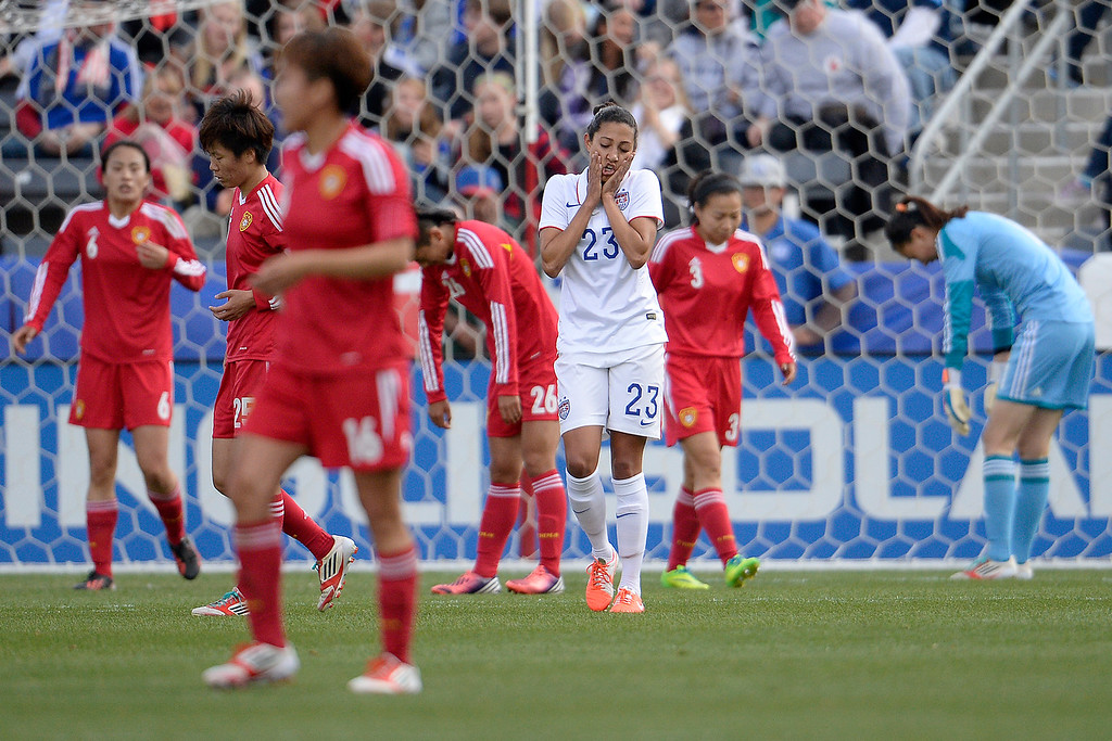 . Christen Press (23) of the U.S.A. reacts to missing a shot on goal against China during the first half of women\'s soccer action. Dick\'s Sporting Goods Park on Sunday, April 6, 2014. (Photo by AAron Ontiveroz/The Denver Post)