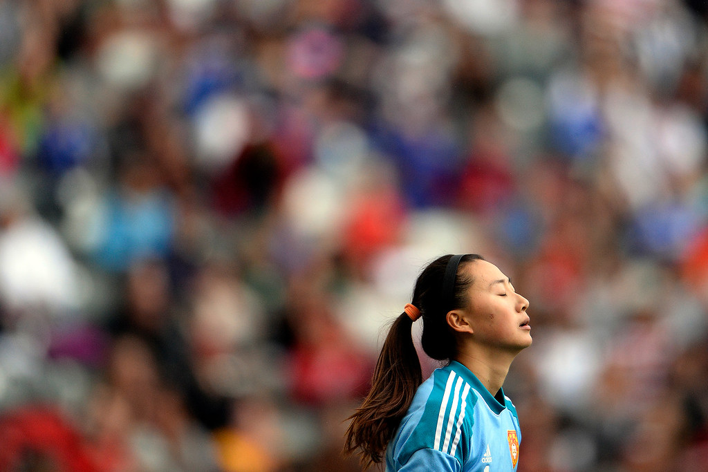 . Zhang Yue (1) of China takes a breather against the U.S.A. during the second half of the U.S.A.\'s 2-0 win. Dick\'s Sporting Goods Park on Sunday, April 6, 2014. (Photo by AAron Ontiveroz/The Denver Post)