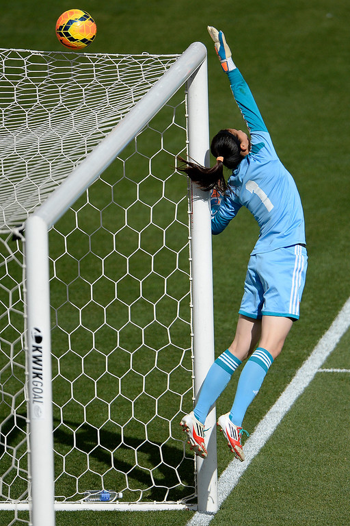 . Zhang Yue (1) of China stops a shot by Ali Krieger (11) of the U.S.A. during the second half of the U.S.A.\'s 2-0 win. Dick\'s Sporting Goods Park on Sunday, April 6, 2014. (Photo by AAron Ontiveroz/The Denver Post)