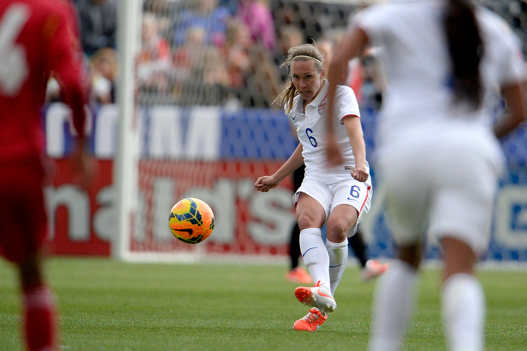 . Whitney Engen (6) of the U.S.A. passes the ball against China during the second half of the U.S.A.\'s 2-0 win. Dick\'s Sporting Goods Park on Sunday, April 6, 2014. (Photo by AAron Ontiveroz/The Denver Post)