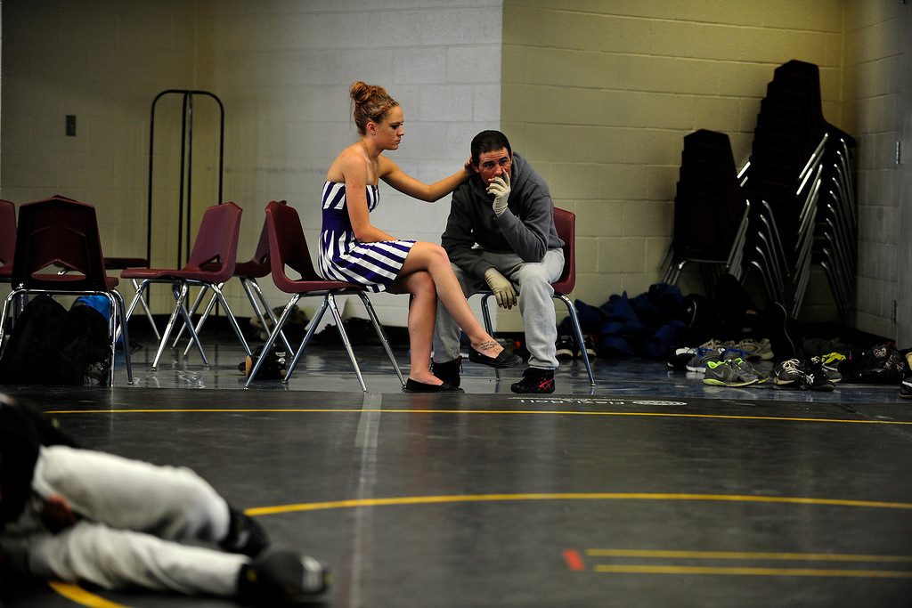 . PAGOSA SPRINGS, CO. - JUNE 6: Michael Martinez sits with his girlfiend  Kaitlin Mastin at Pagosa Springs High School, May 6, 2013. Martinez, working as a clinician at the Wrestle the World wrestling camp, takes a break from work because he tires easily due to his severe burns.  (Photo By Mahala Gaylord/The Denver Post)