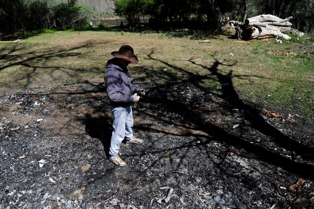 . PAGOSA SPRINGS, CO. - MAY 6: Michael Martinez, 27, stands on the remains of his parent\'s camper that exploded when Martinez was in it.  (Photo By Mahala Gaylord/The Denver Post)