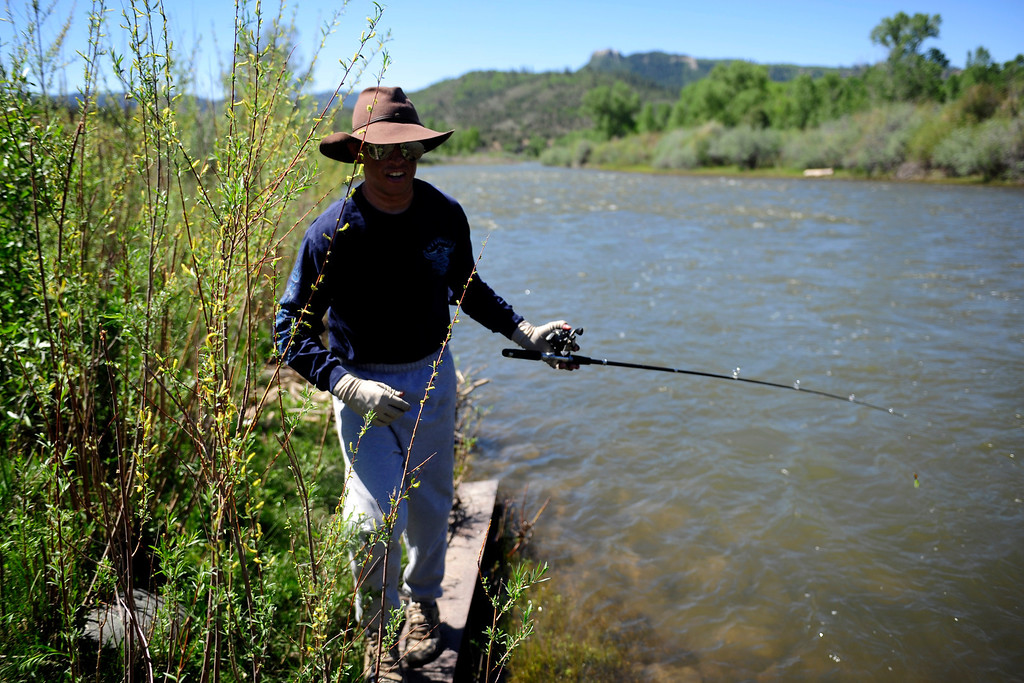 . PAGOSA SPRINGS, CO. - JUNE 6: Michael Martinez, 27, keeps his skin fully covered from the sun while taking a short break to go fishing at his family ranch in Pagosa Springs, CO on May 6, 2013. Martinez was staying in his family\'s camper on the ranch on April 2, 2013 when the camper exploded due to a propane leak when Martinez lit a match in the middle of the night to start a burner.  (Photo By Mahala Gaylord/The Denver Post)