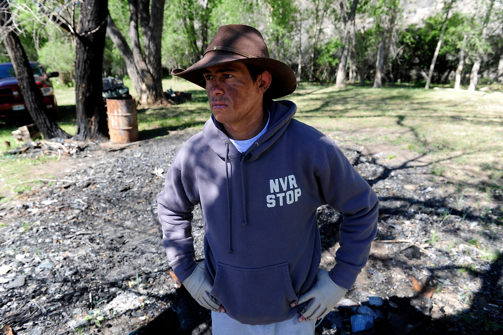 . PAGOSA SPRINGS, CO. - JUNE 6: Michael Martinez, 27, stands on the remains of his parent\'s camper that exploded when Martinez was in it on April 2, 2013. The two-time state wrestling champion at Pagosa Springs High School and three-time Western Wrestling Conference champion at Wyoming, survived the propane explosion but eighty percent of his body was covered in 2nd and 3rd degree burns. (Photo By Mahala Gaylord/The Denver Post)