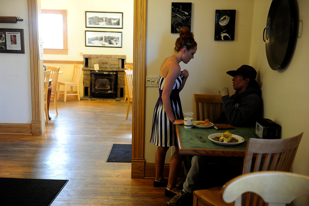 . PAGOSA SPRINGS, CO. - JUNE 6: Michael Martinez talks with his girlfriend Kaitlin Mastin at Pagosa Baking Co. where Mastin works, May 6, 2013. The two started dating two months before Martinez was caught in a propane explosion on April 2, 2013, that blew up a camper on his parents ranch. Eighty percent of his body was covered in 2nd and 3rd degree burns. The community of Pagosa Springs turned out to support Martinez during his recovery including the owners of Pagosa Baking Co. whom Martinez had never met before they visited him in the hospital. (Photo By Mahala Gaylord/The Denver Post)