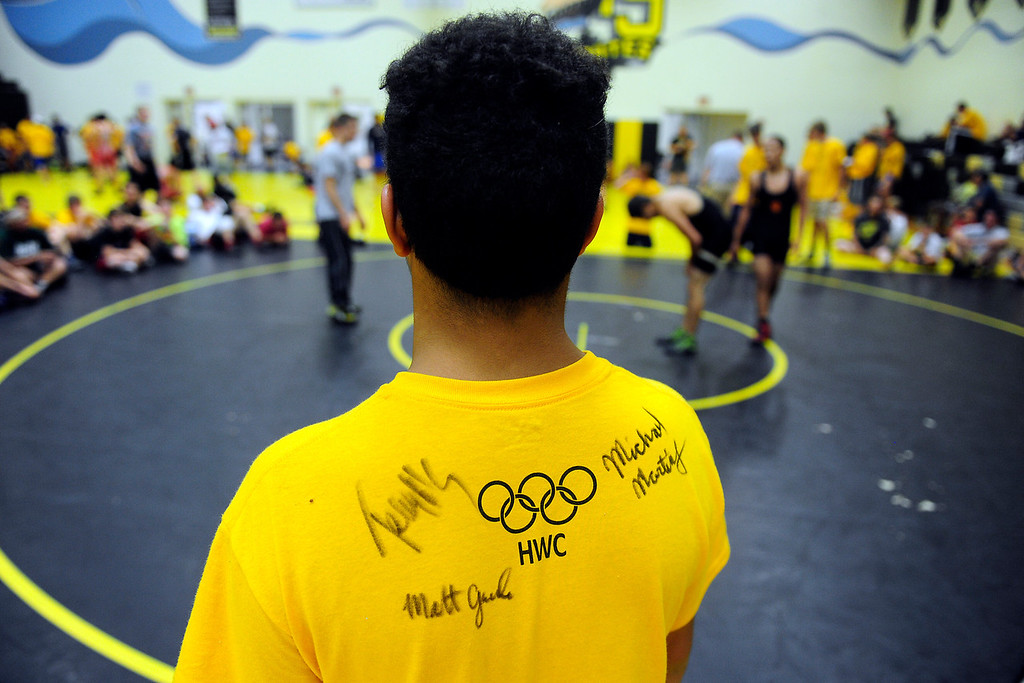 . PAGOSA SPRINGS, CO. - JUNE 6: Elijah Gughrie, 15, a wrestler for Pagosa Springs High School asked Michael Martinez to sign his shirt at the Wrestle the World wrestling camp held at the high school the week of June 3-7. Martinez worked with a lot of the campers on technique. (Photo By Mahala Gaylord/The Denver Post)