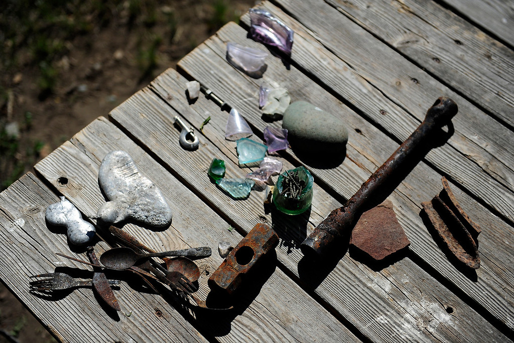 . PAGOSA SPRINGS, CO. - JUNE 6: Michael Martinez, 27, two-time state wrestling champion at Pagosa Springs High School and three-time Western Wrestling Conference champion at Wyoming, survived a propane explosion on April 2, 2013, that blew up a camper on his parents ranch. Remnants from the explosion rest on a picnic table nearby.  (Photo By Mahala Gaylord/The Denver Post)
