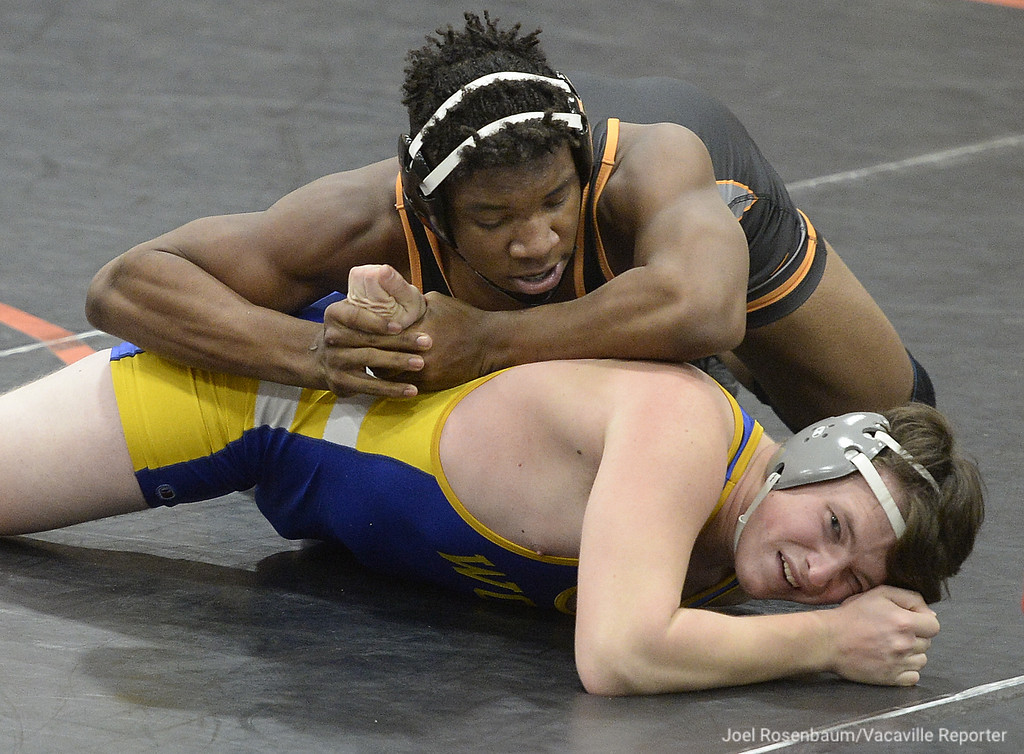 . Vaca High�s Chris Island battles Wood�s Cameron Oliver during their 197 pound match during the Bulldogs duel meet against the Wildcats. Island pinned Oliver and the �Dogs won the meet 62-6.