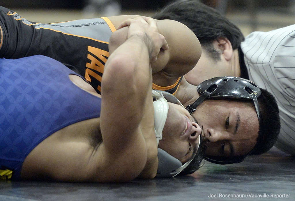 . Vaca High�s Jacob Peralta battles Wood�s Alex Rivera during their 128 pound match during the Bulldogs duel meet against the Wildcats. Peralta won by major decision and the �Dogs won the meet 62-6. Joel Rosenbaum -- The Reporter