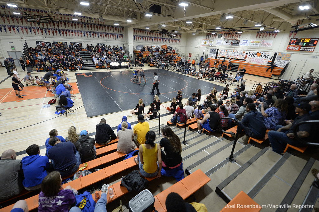 . Fans fill Harold Youngblood Gymnasium as the cross-town rivals Vacaville and WIll C. Wood High School faceoff in the final wrestling dual meet of the league season Wednesday at Vaca High.