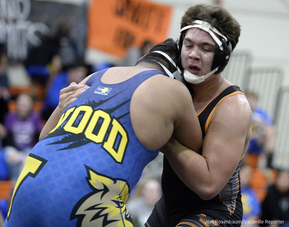 . Vaca High�s Jake Levengood battles Wood�s Javier Contreras during their 285 pound match during the Bulldogs duel meet against the Wildcats. Levengood pinned Contreras and the �Dogs won the meet 62-6 Wednesday at Harold Youngblood Gymnasium.