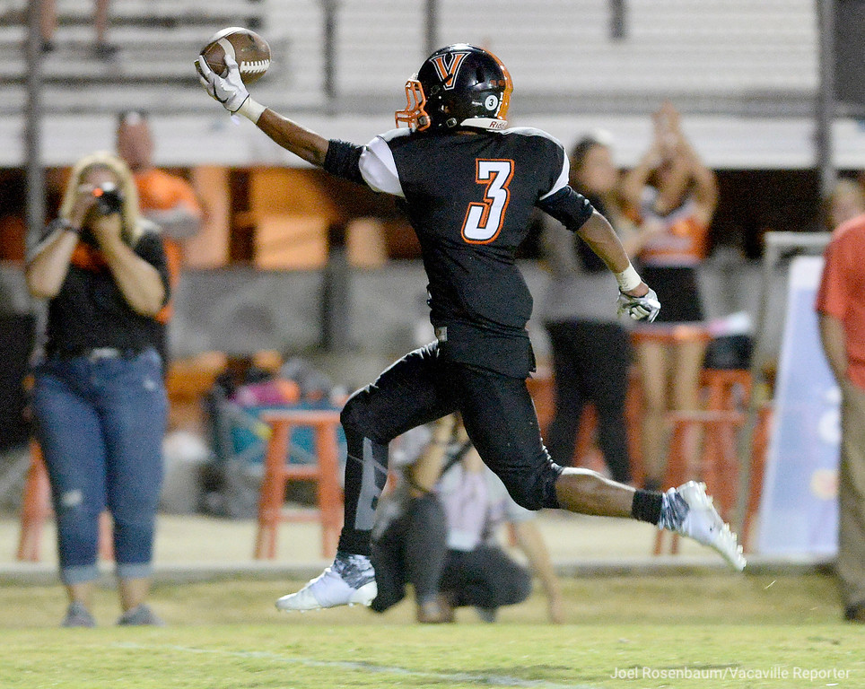 . Vaca High\'s Nick Smith celebrates as he returns a punt for a touchdown during the third quarter.