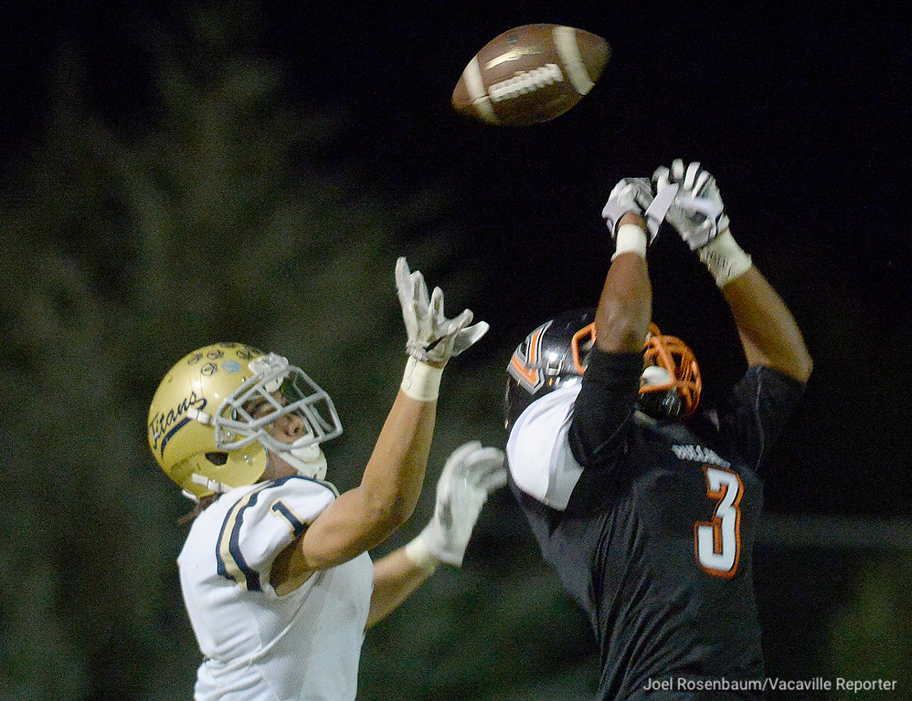 . Vaca High cornerback, Nick Smith knocks away an touchdown pass intended for Burbank High\'s Levelle Bailey during the first quarter.