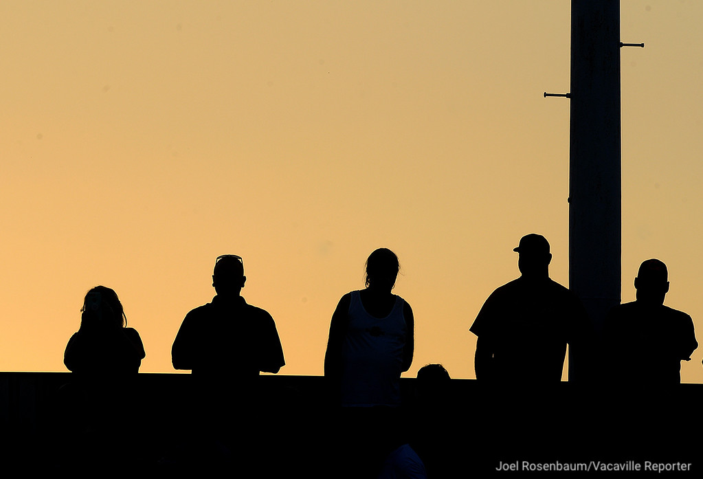 . Vaca High fans watch the pregame warmups Friday at Tom Zunino Stadium.