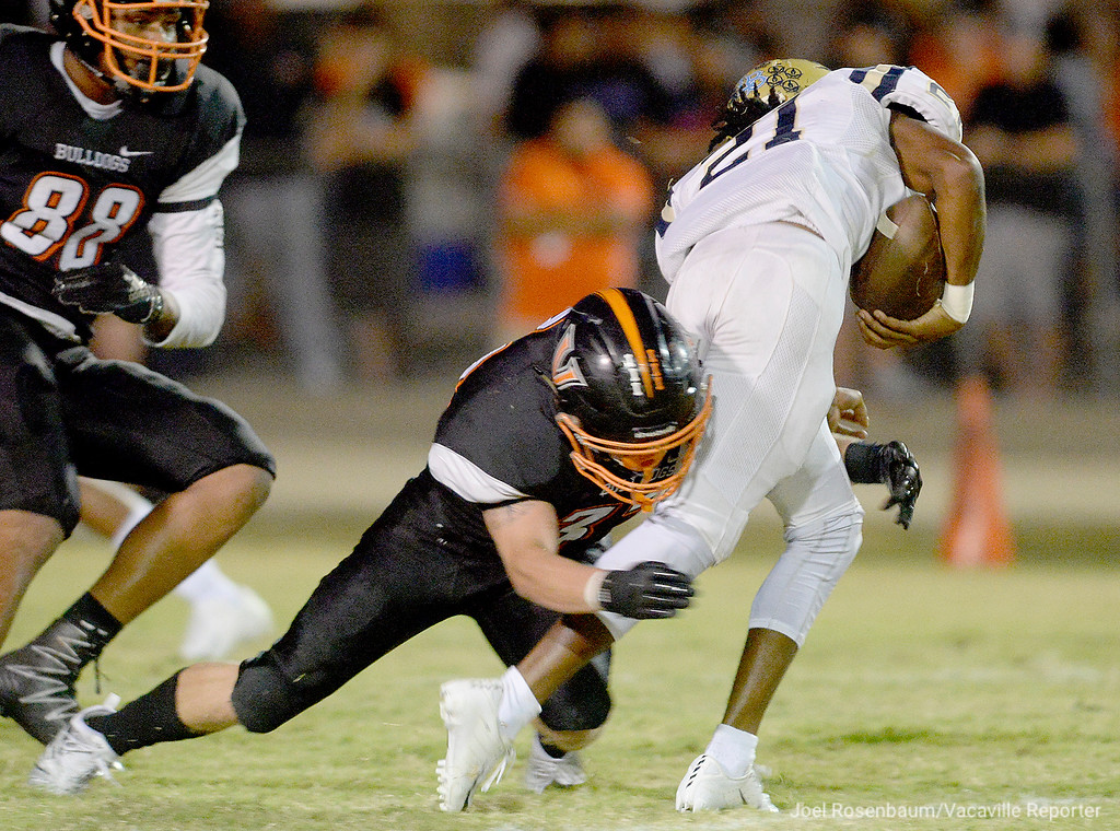 . Vaca High\'s Talon Abramowicz wraps up Burbank High\'s Darius Daniel behind the line of scrimmage during the second quarter.