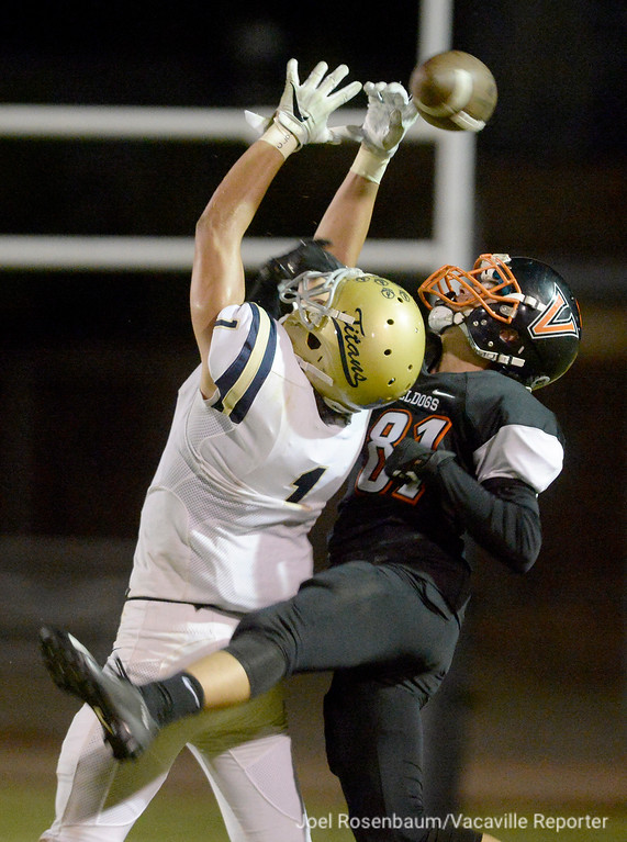 . Vacaville High safety Trevor Marshall knocks a pass away from Burbank High School\'s Levelle Bailey during the second quarter of the Bulldogs\' 40-14 rout of the Titans in non-league action Friday at Tom Zunino Stadium.