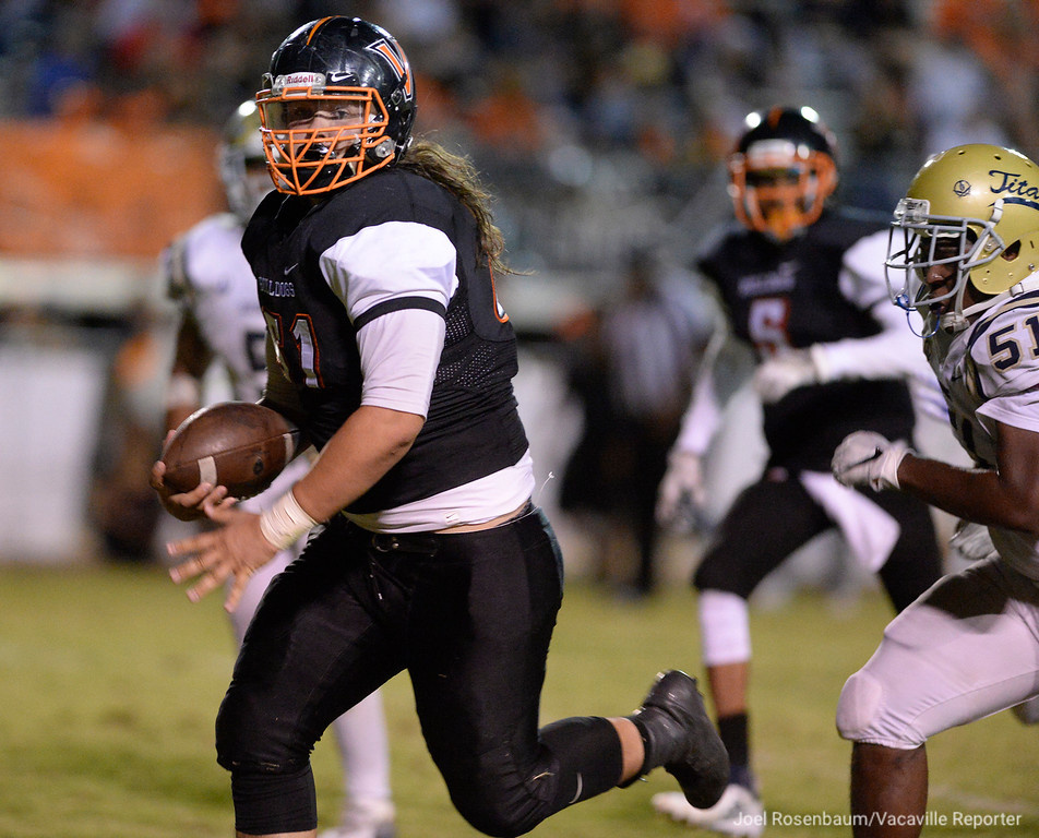 . Vaca High defensive tackle, Nash Clegg sprints away from Burbank High\'s Michael Knox after he recovered a fumble during the second quarter, one of three recovered in the second quarter.