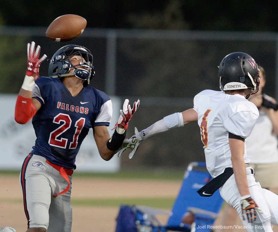 . Vacaville Christian High School, Jaron Leaks can�t haul in the ball as he battles Foresthill High School safety, Cole Moore for a reception during the second quarter of the Falcons� 41-10 rout of the Wildfires in non-league action Friday at Falcon Field.