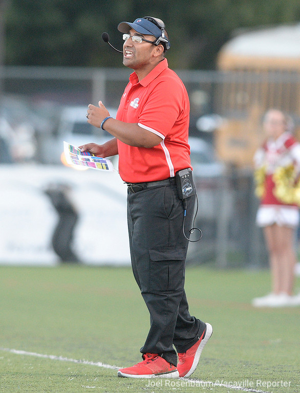 . Vacaville Christian High School head football coach, Manny Tarango calls out to his players during the first quarter of the Falcons\' 41-10 rout of Foresthill High School Friday at Falcon Field.