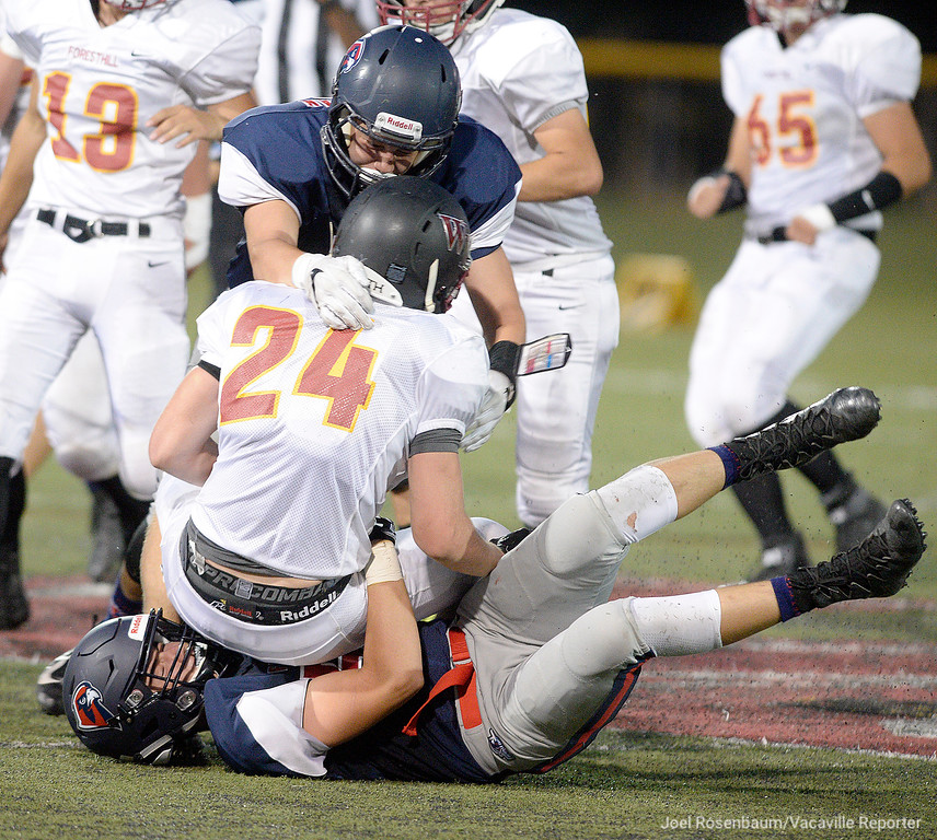 . Vaca Christian High linebackers, Bryce Pazdel (bottom) and Chris Lespron sack Foresthill High running back, Caleb Westphalen during the second quarter of the Falcons\' 41-10 rout of the Wildfires Friday at Falcon Field.