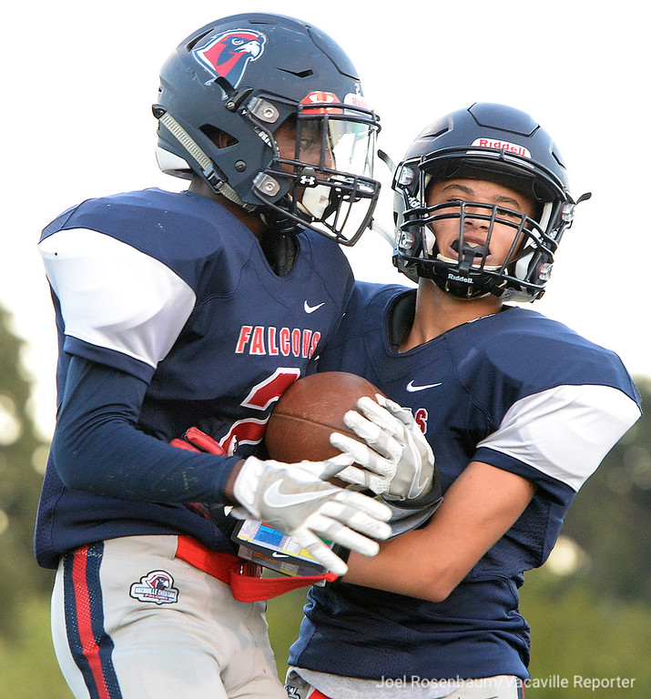 . Vacaville Christian High running back, Tamani Williams  celebrates his first quarter touchdown with teammate, Kendall Allen.