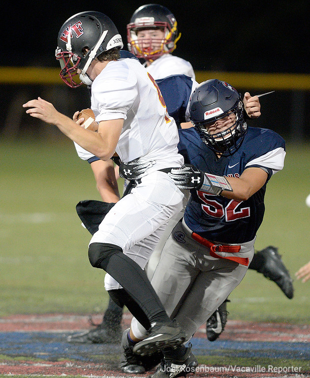 . Vaca Christian linebacker, Bryce Pazdel wraps up Foresthill quarterback, Kaiden Pennington for a sack during the second quarter.