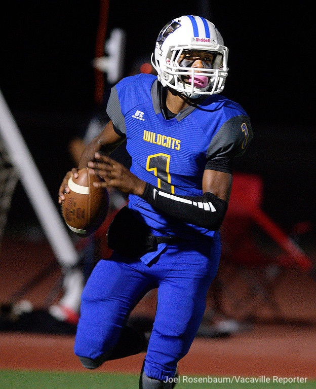 . Will C. Wood high quarterback, Jhalen Grayer rolls out as he looks for a open receiver late in the second quarter.
