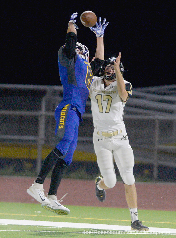 . Will C. Wood defensive back, Isaac Pewitt knocks away a pass intended for American Canyon wide receiver, Billy Biondini during the second quarter of the Wildcats 28-22 victory over the Wolves Friday at Wildcat Stadium.
