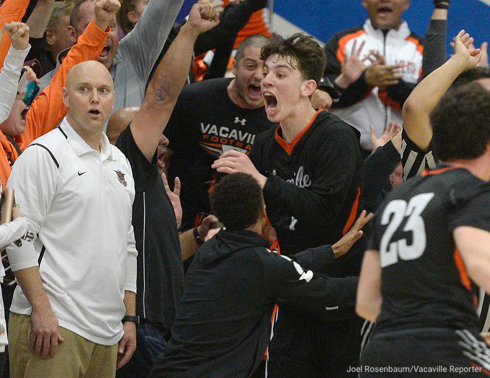 . Vaca High\'s Zack Perlstein (middle) begins to celebrate with his teammates as head coach Duane Kamman (left) looks on in shock after he hit a shot from just past half-court shot as the buzzer sounded to win the showdown with Will C. Wood 59-57 Thursday at Frank Molina Gymnasium.