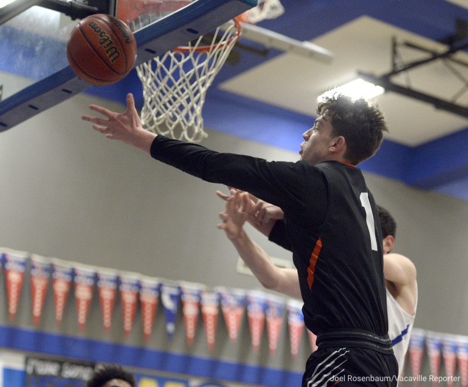 . Vaca High\'s Zack Perlstein tracks down a defensive rebound during the first quarter.