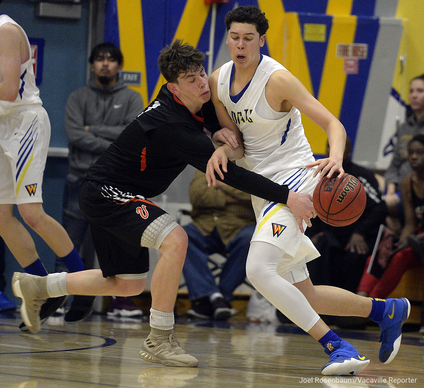 . Vaca High\'s Zack Perlstein knock the ball away from Wood\'s Jay Nagel during the fourth quarter of the Bulldogs thrilling 59-57 victory over the Wildcats Thursday at Wood.
