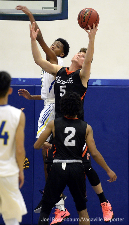 . Vaca High\'s Aaron Spurling pulls down an offensive rebound as Ricky Holland challenges him during the third quarter.