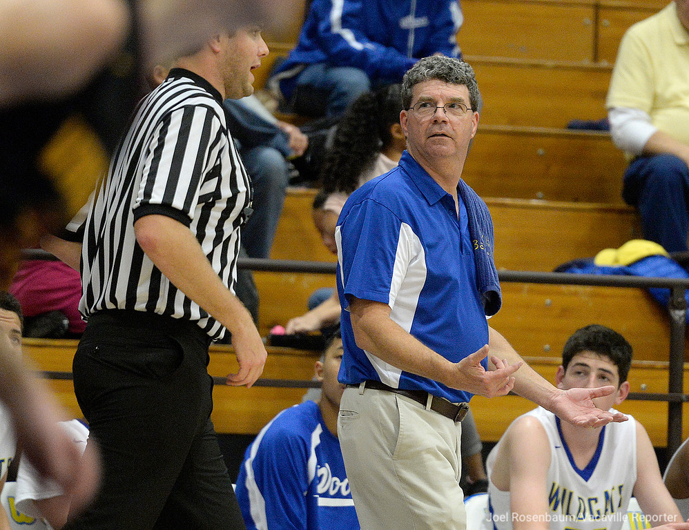. Wood head basketball coach, Mark Wudel questions a call by the referee during the the third quarter.