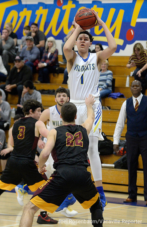. Wood\'s Jay Nagle fires a shot over the Vintage defense during the first quarter of the Wildcats league opening victory over the Crushers Friday at Frank Molina Gymnasium. Joel Rosenbaum -- The Reporter