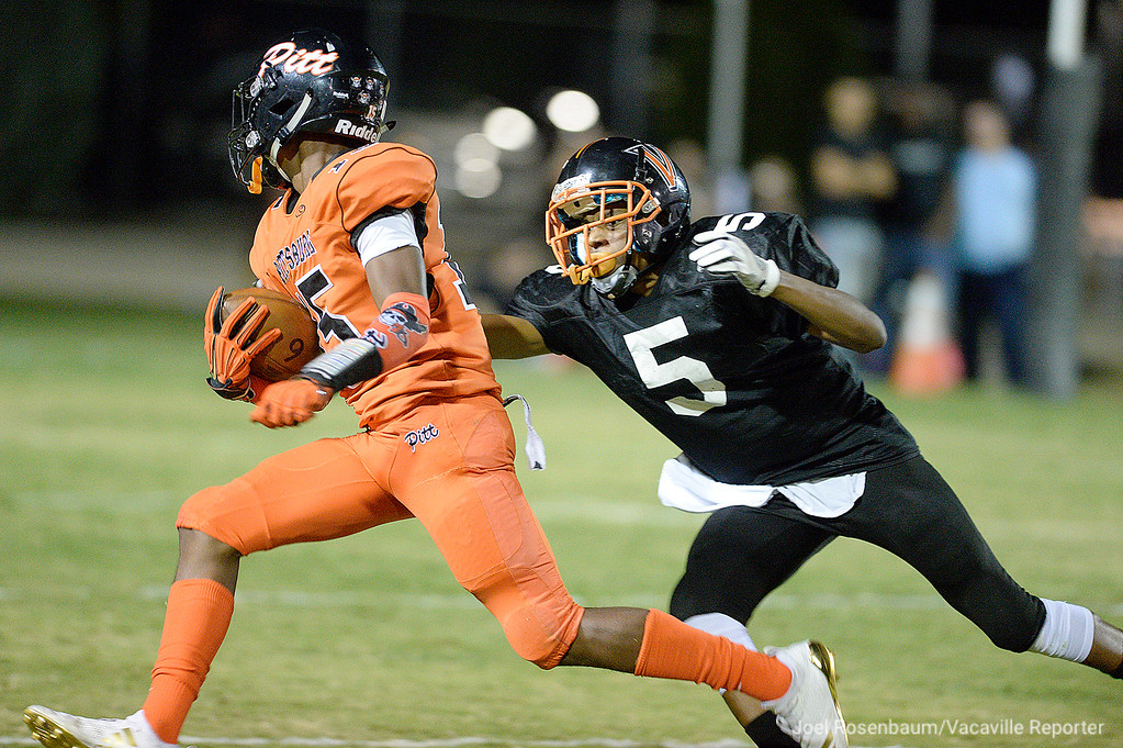 . Vaca High defensive back, Myron Amey, tracks down Pittsburg High wide receiver, Justin Boyd during the first quarter.