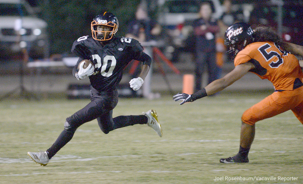 . Vaca High running back, Geremiah Brown sprints away from PIttsburg High\'s Enele Amituanai during the first quarter of the Bulldogs 40-7 loss to the Pirates.
