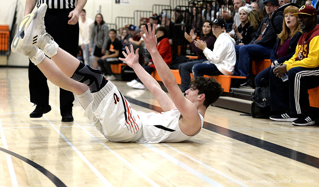 . Vaca High\'s Zack Perlstein slides across the floor as he looks to the referees after getting fouled by a Napa High player as he drove to the basket during the first quarter. Perlstein scored 29 points in the Bulldogs\' 63-51 victory over the Indians Tuesday at Vaca High.