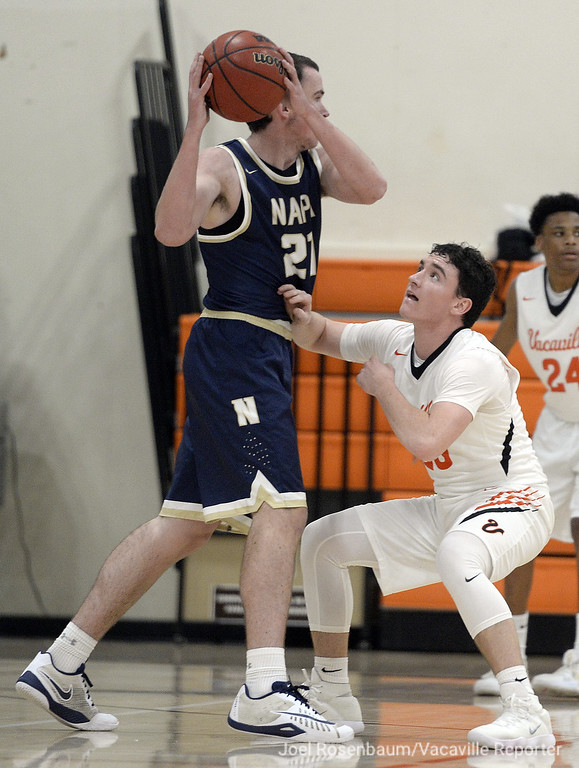 . Vacaville High\'s Cameron Mitchell pressures Napa High\'s Charles Gravett during the first quarter.