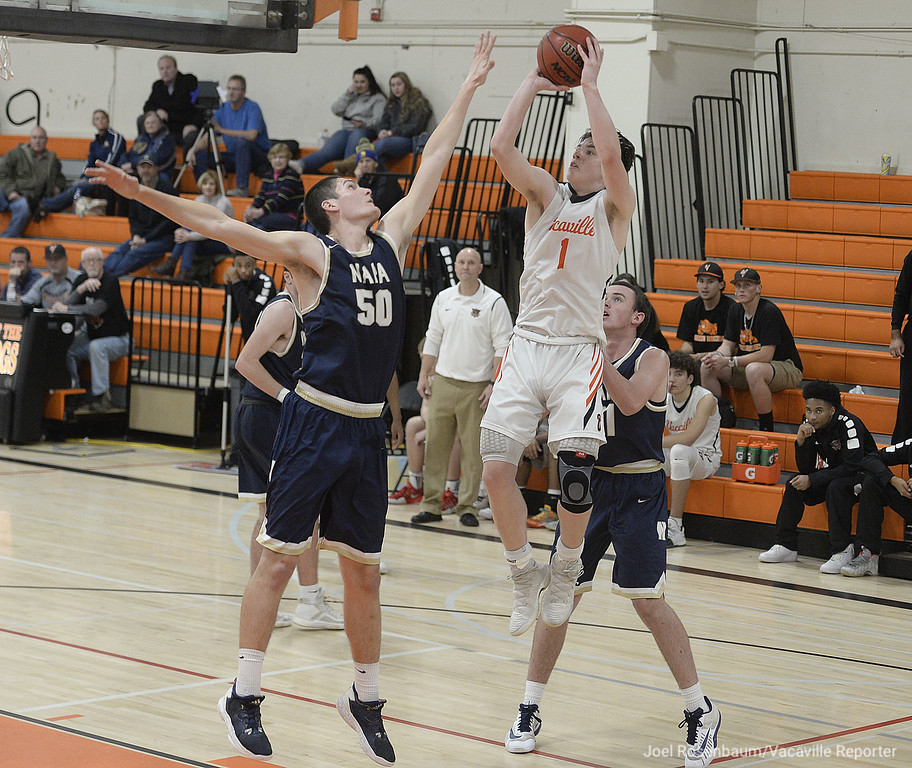 . Vacaville High\'s Zack Perlstein puts up a jump shot over the defensive pressure of Napa High School\'s Mitch Hippauf (50) during the third quarter of the Bulldogs\' 63-51 victory  over the IndiansTuesday at Vaca High. Perlstein led all player with 29 points in the contest.