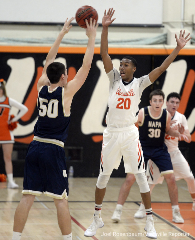 . Vacaville High\'s CJ Toler pressures Napa High\'s Mitch Hippauf during the third quarter.