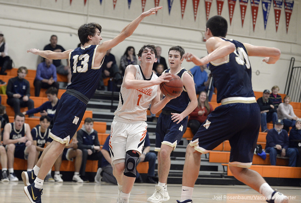. Vaca High\'s Zack Perstein drives through three Napa High defenders on his way to scoring two of his 29 points in the Bulldogs\' 63-51 victory over the Indians Tuesday at Harold Youngblood Gymnasium.