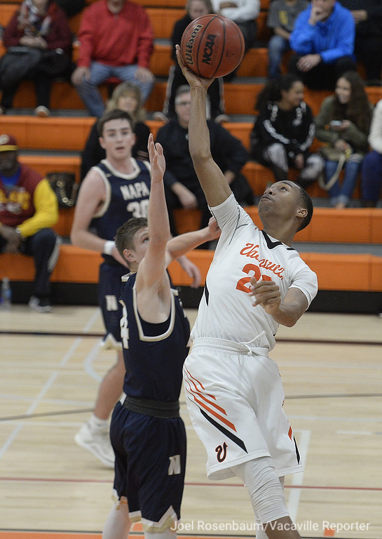 . Vaca High\'s CJ Toler fights for control of a loose ball with Napa High\'s Stephen Blume during the second quarter.