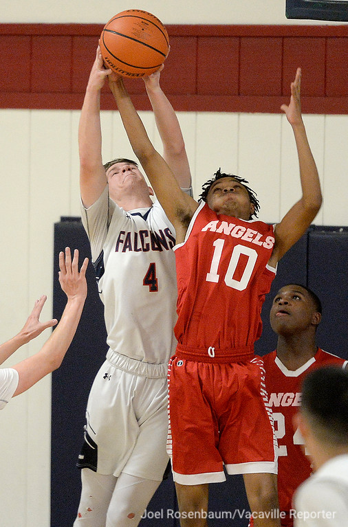 . Vacaville Christian\'s Quinlan Sweany battles with Alpha Charter\'s Morris Johnson for a rebound during the second quarter of the Falcons\' 62-38 victory in the first round of the CIF Sac Joaquin Section Division VI Championships Friday at Vaca Christian High.