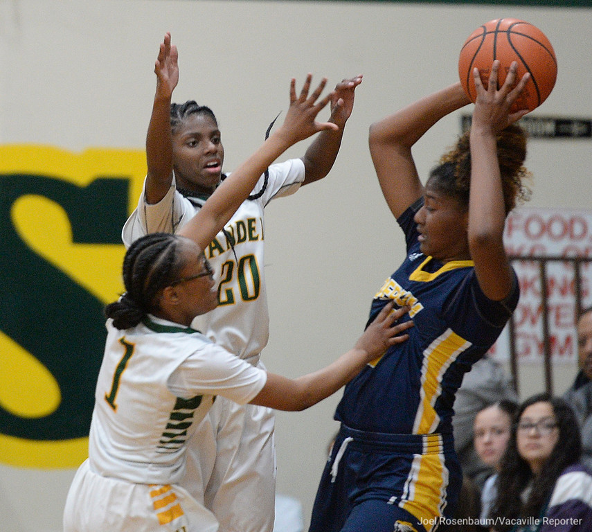 . Vanden\'s Tyliyah Grady (left) and Deirdre Huff double-team Inderkum High\'s Shauna Jackson during the second quarter of the Vikings 71-66 overtime victory in the first round of the 2018 CIF Sac Joaquin Section Division II Championships Tuesday at Jim Boyd Gymnasium.