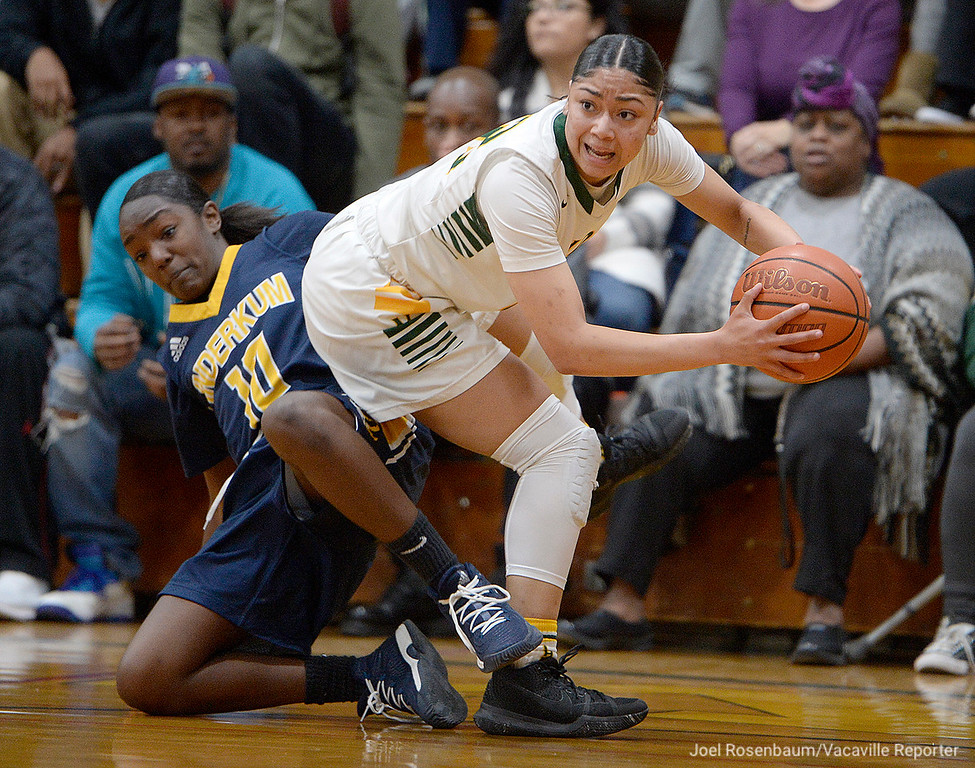 . Vanden\'s Myli Martinez looks for an open teammate as she gets tied up by Inderkum High\'s Naomi Dillard during the first  quarter of the Vikings\' 71-66 overtime victory in the first round of the 2018 CIF Sac Joaquin Section Division II Championships Tuesday at Jim Boyd Gymnasium.