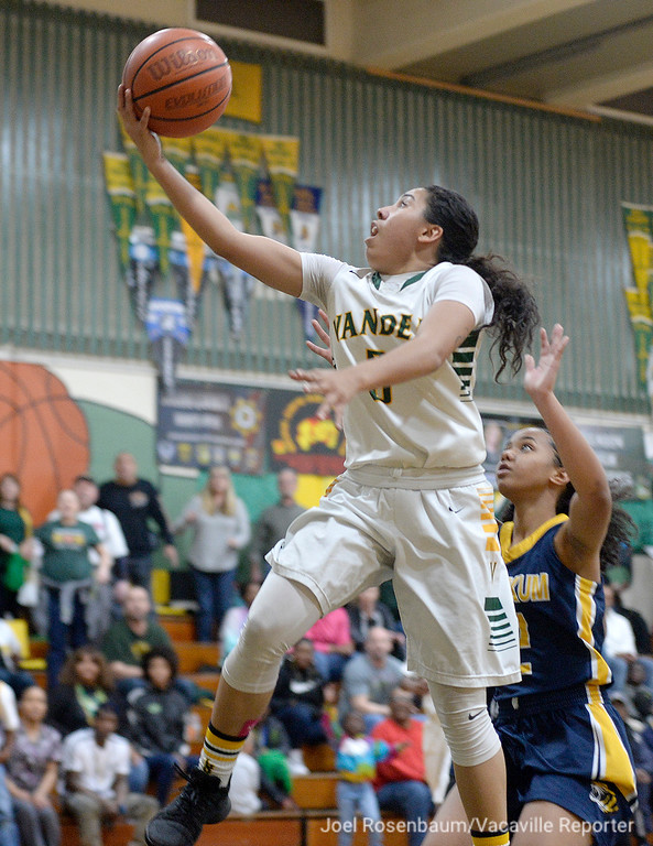 . Vanden\'s Jenessa Herrera drives to the basket on a break away drive during overtime of the Vikings\' 71-66 overtime victory in the first round of the CIF Sac Joaquin Section Division II Championships.
